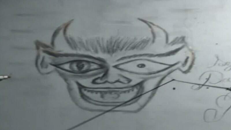Desenho que remete ao demônio estava na parede do local do crime